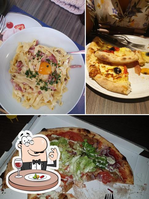 La photo de la nourriture et intérieur de La Caravelle Restaurant-Pizzeria's