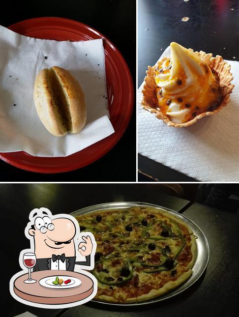 Dê uma olhada a imagem ilustrando comida e exterior a Rock Pizza