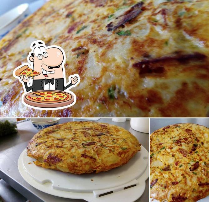 Tómate una pizza en Te Aroha Place