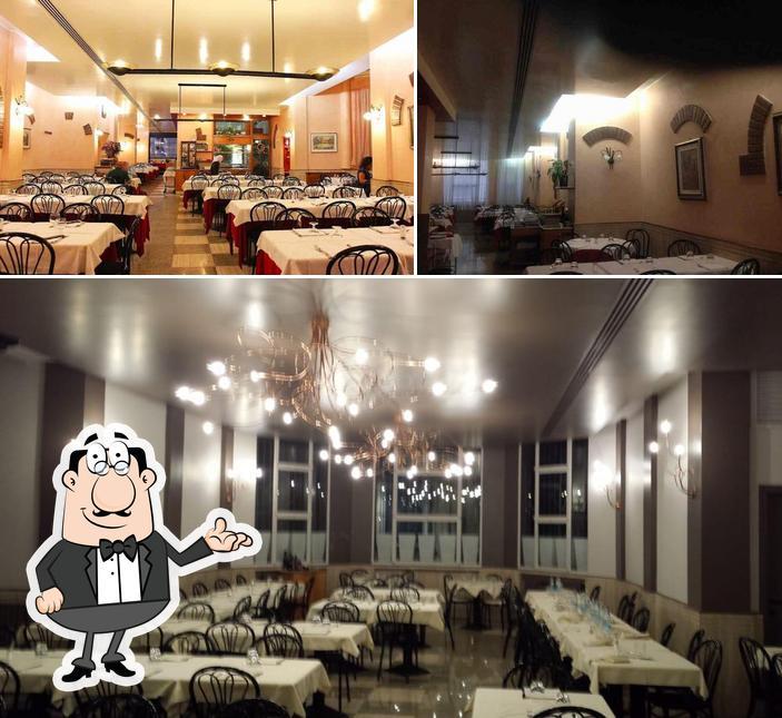 La immagine di interni e tavolo da pranzo da Acero Rosso