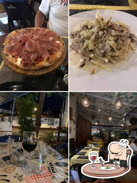 This is the photo depicting food and interior at L'angolo Di Napoli