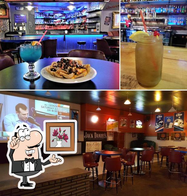 The picture of interior and beverage at The Pheasant Blue Collar Bar & Grill