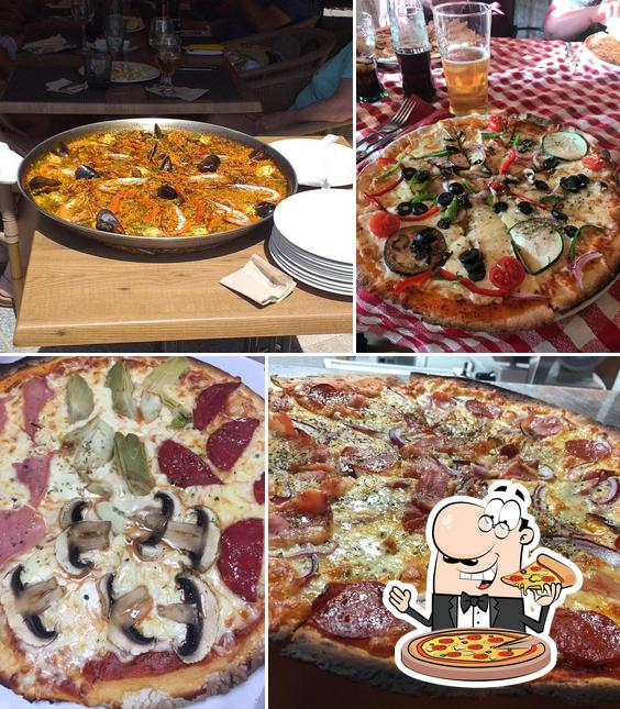 Get pizza at Manolo's