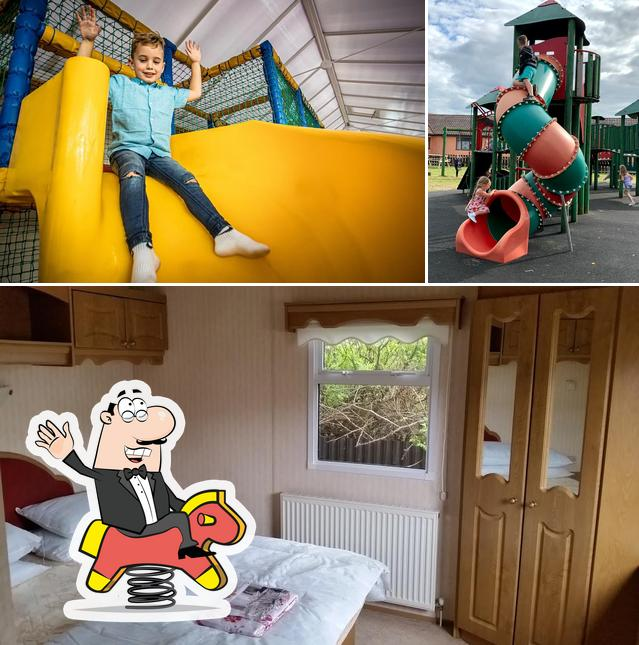 Among different things one can find play area and interior at Lyons Robin Hood Holiday Park