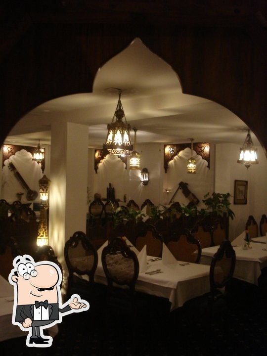 Take a seat at one of the tables at Lahore Palace