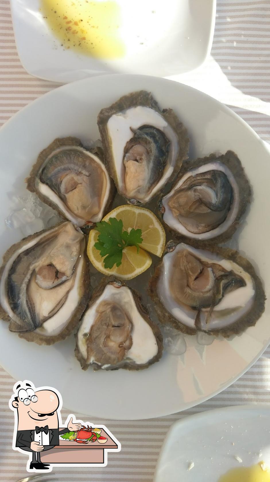 Get seafood at Snack bar Rio