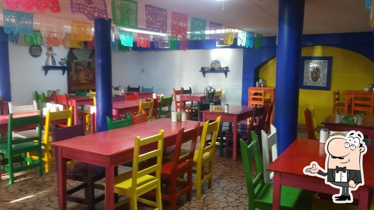 Take a seat at one of the tables at La Choza