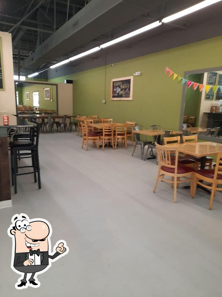 Take a seat at one of the tables at Brew to Brew